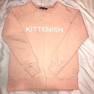 Kittenish peach sweater
